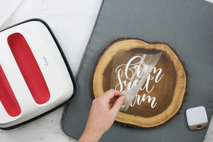 wood slice with Cricut iron-on