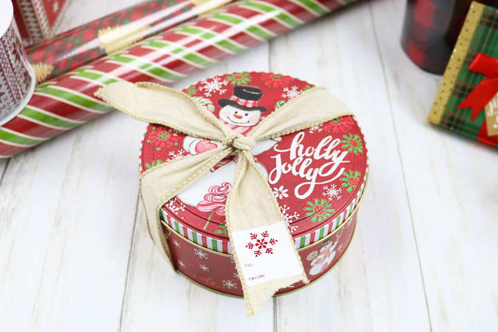 wrapping up a cookie tin