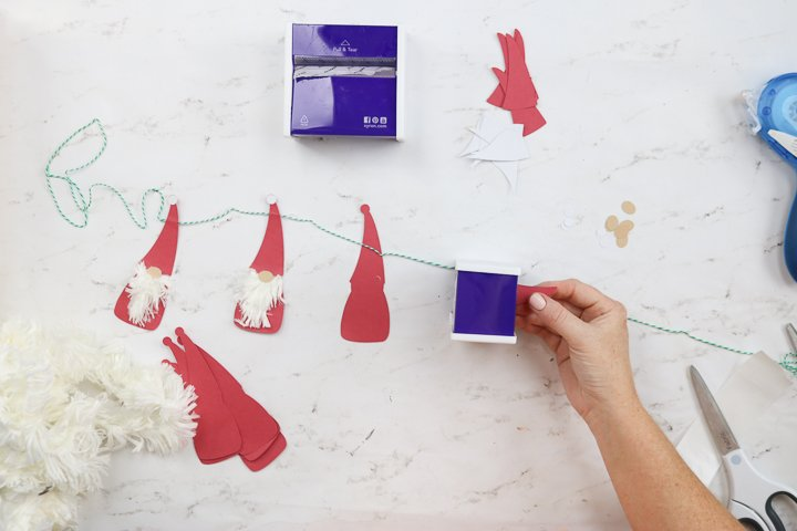 Use the Xyron Sticker Maker to create the beard for your Christmas gnome banner