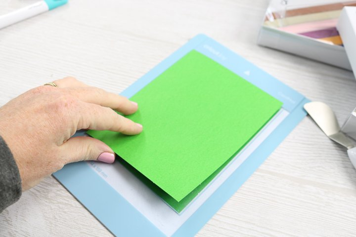 cutting a card on a cricut mat