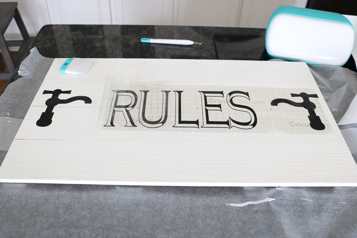 using cricut vinyl on a bathroom sign