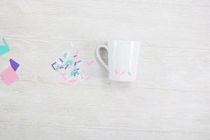 adding sprinkles on a coffee mug
