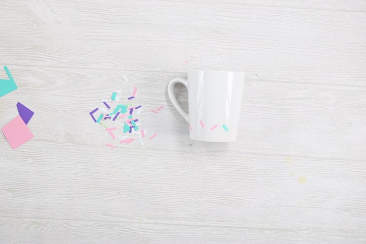 adding sprinkles on a coffee mug