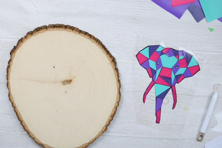 vinyl art to be added to a wood slice