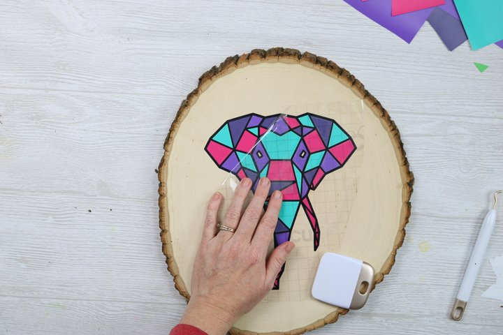 adding vinyl to a wood slice