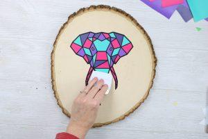 colorful elephant on wood