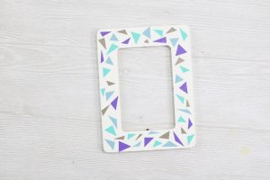 adding vinyl triangles to a picture frame