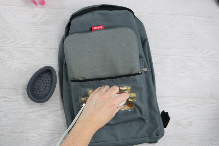adding heat transfer vinyl to a backpack