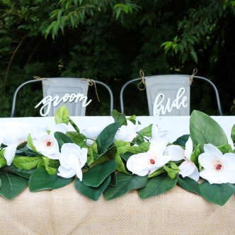 wedding table with diy magnolia garland
