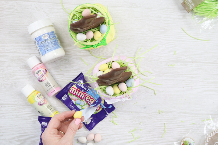 adding candy to an easter mason jar
