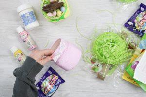 putting ribbon around the top of a mason jar