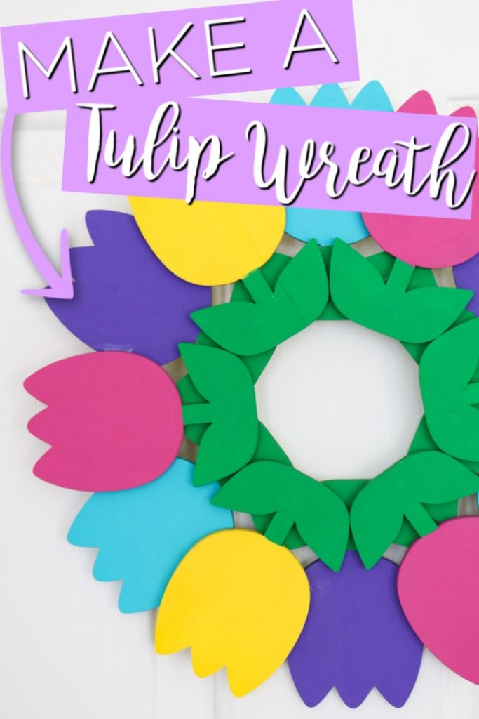 Make a tulip wreath with a few supplies! This will look great on your front door this spring! #spring #wreath #tulips #wood #woodcrafts #springwreath #springcrafts