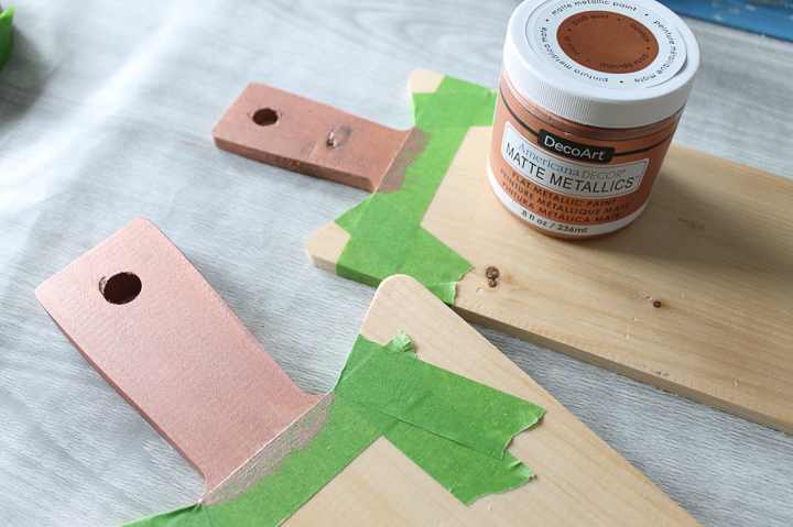 adding paint to a wood cutting board
