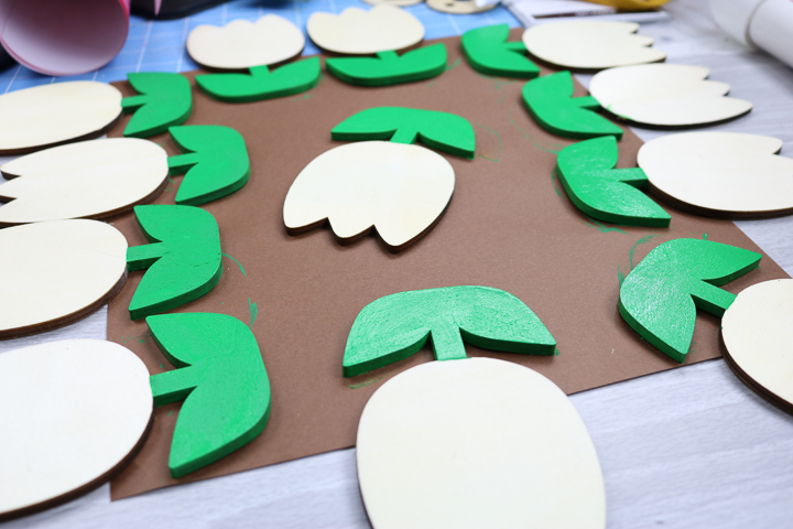 painting leaves and stems of wood tulips