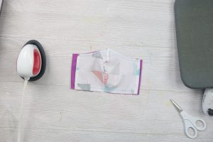 completing the sewing of a face mask