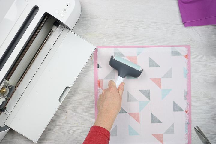 using a brayer on fabric to cut on a cricut maker