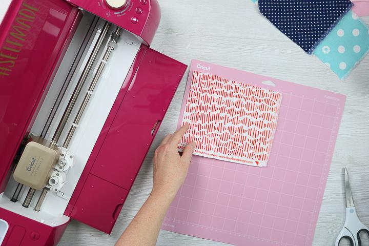 placing fabric on cricut mat
