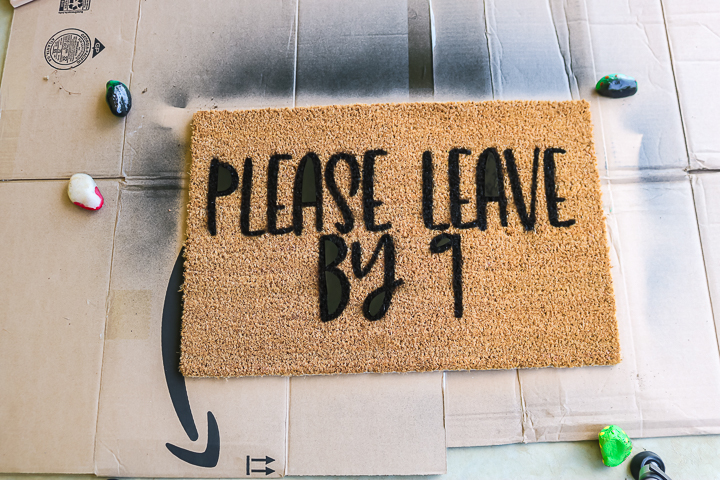 removing a stencil from a doormat