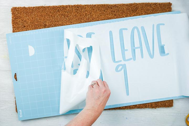 removing a freezer paper stencil from a cricut mat