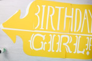 large paper sign on a cricut