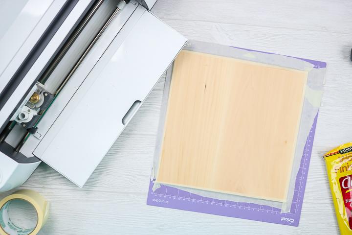 putting wood on a cricut mat