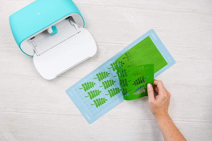 removing scrap paper from cricut mat