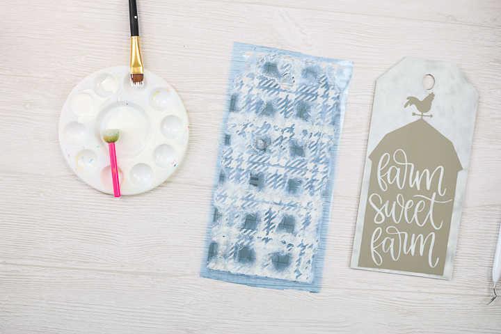 painting a plaid design with a stencil