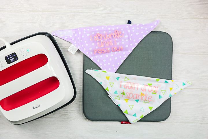 weeded htv ready to be added to a baby bib