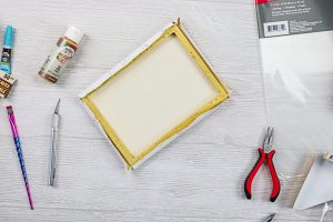 removing canvas to reveal wood frame