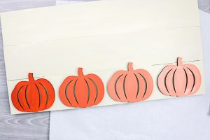 wood pumpkins on a sign