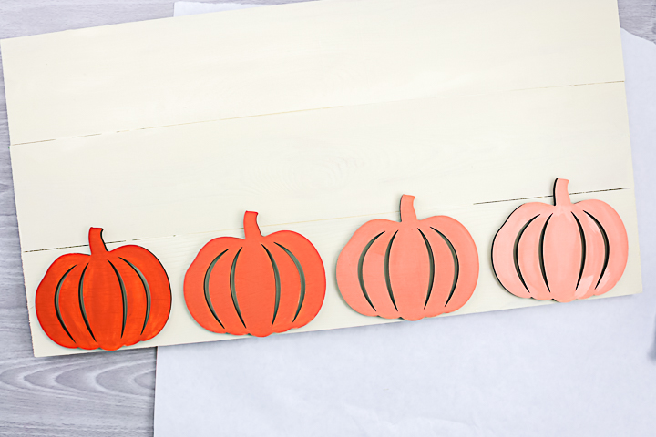 wood pumpkins on a sign