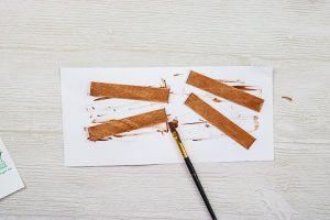 using craft sticks as a poster frame