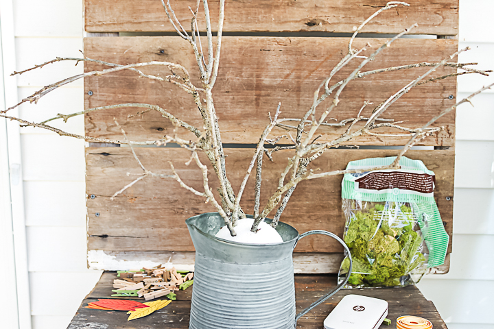 adding branches to fall decor