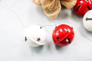adding jingle bells to a wreath