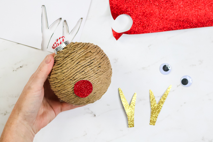 adding reindeer pieces to ornament