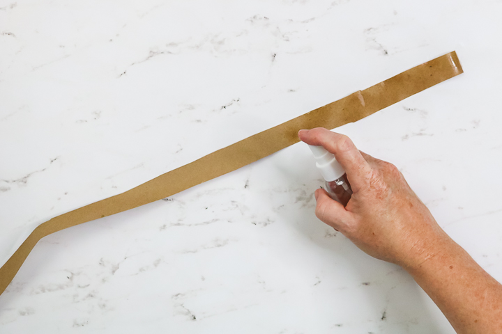 spraying kraft paper with water