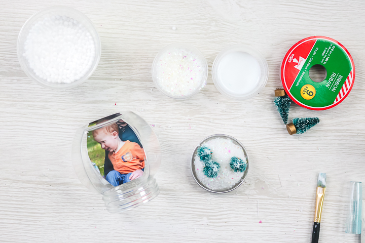 adding trees to a snow globe ornament