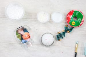adding a photo inside of a plastic jar