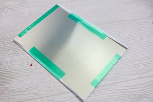 taping copy paper for sublimation to a metal blank