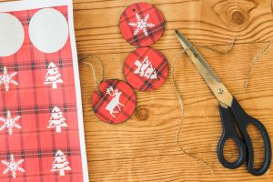 adding twine hangers to ornaments