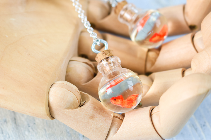 necklace with miniature fish and resin