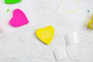 white vinyl saying on a yellow heart box lid