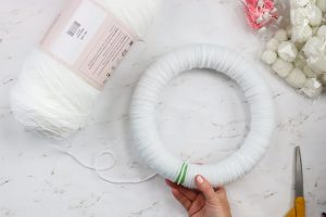 wreath form covered in white yarn
