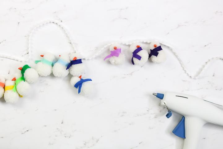 adding snowmen to pom pom string