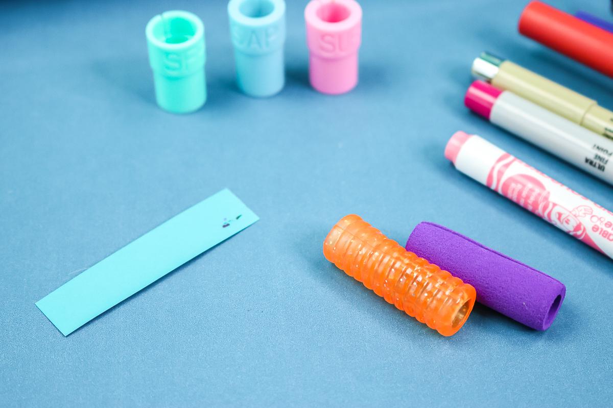 using pencil grips to put pens in cricut machine
