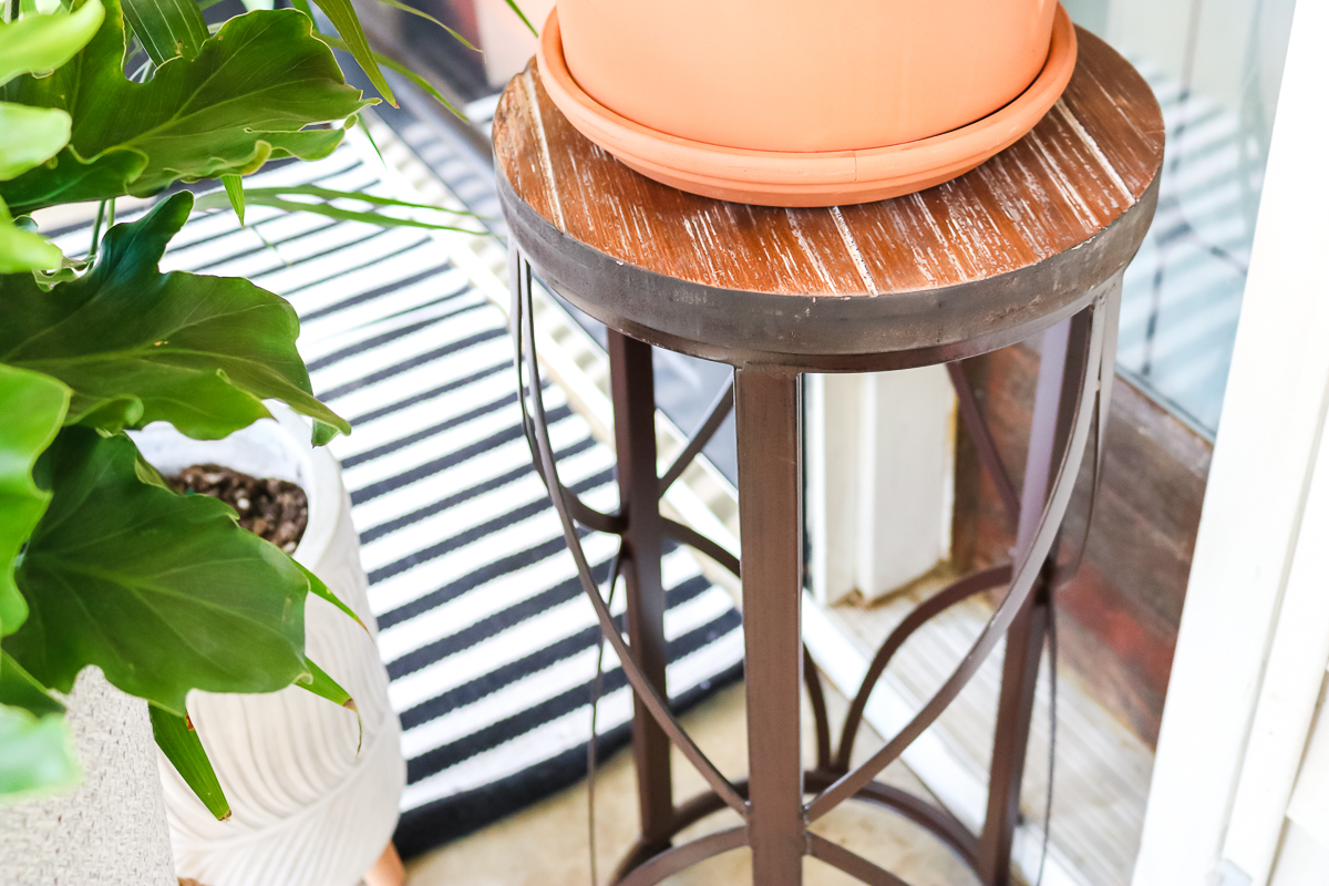 plant stand on a porch