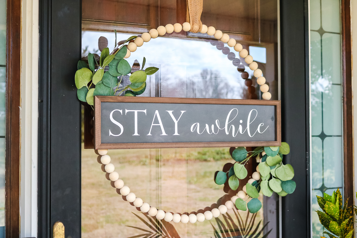 wood bead wreath with a sign