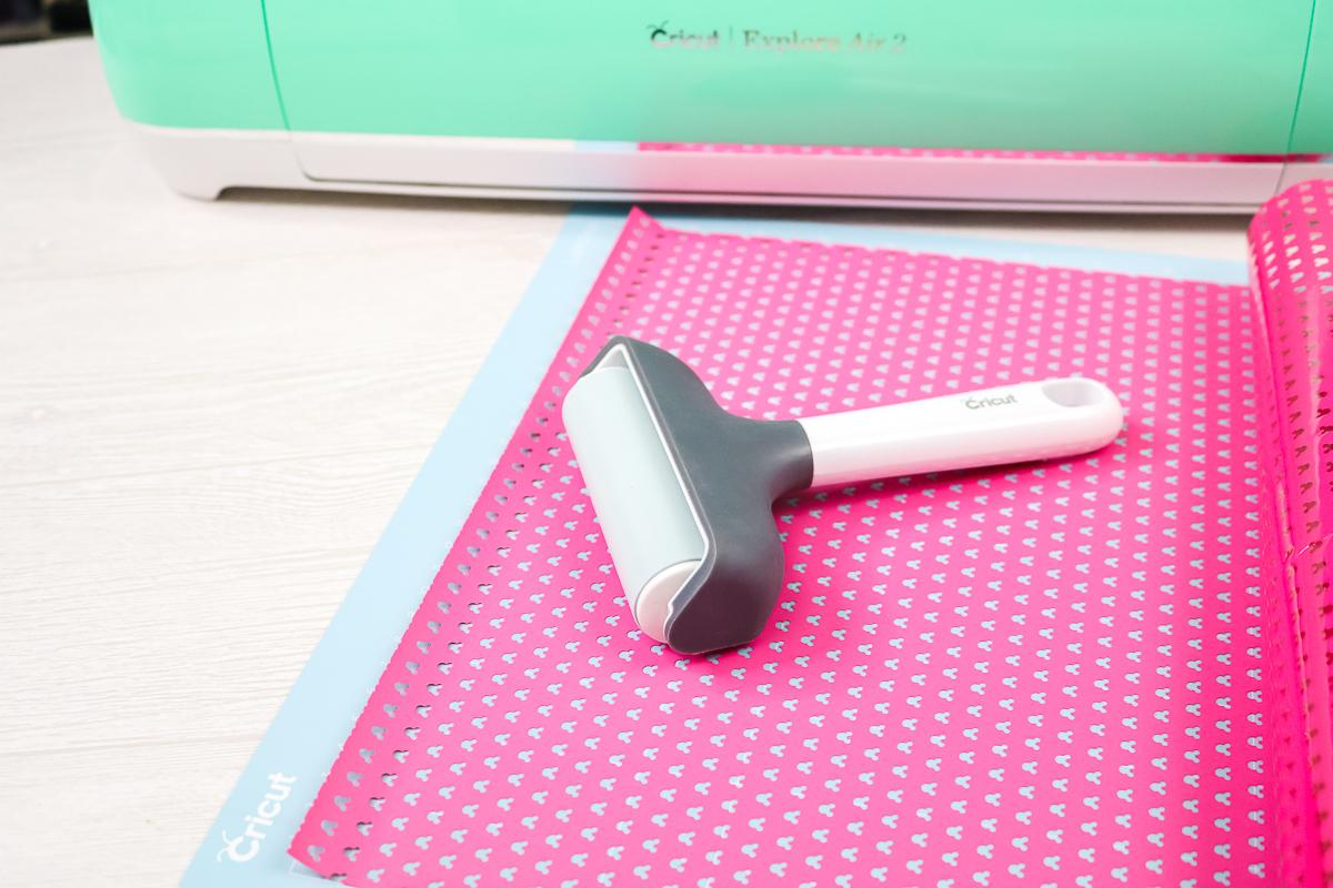 using a brayer to put materials on a cricut mat