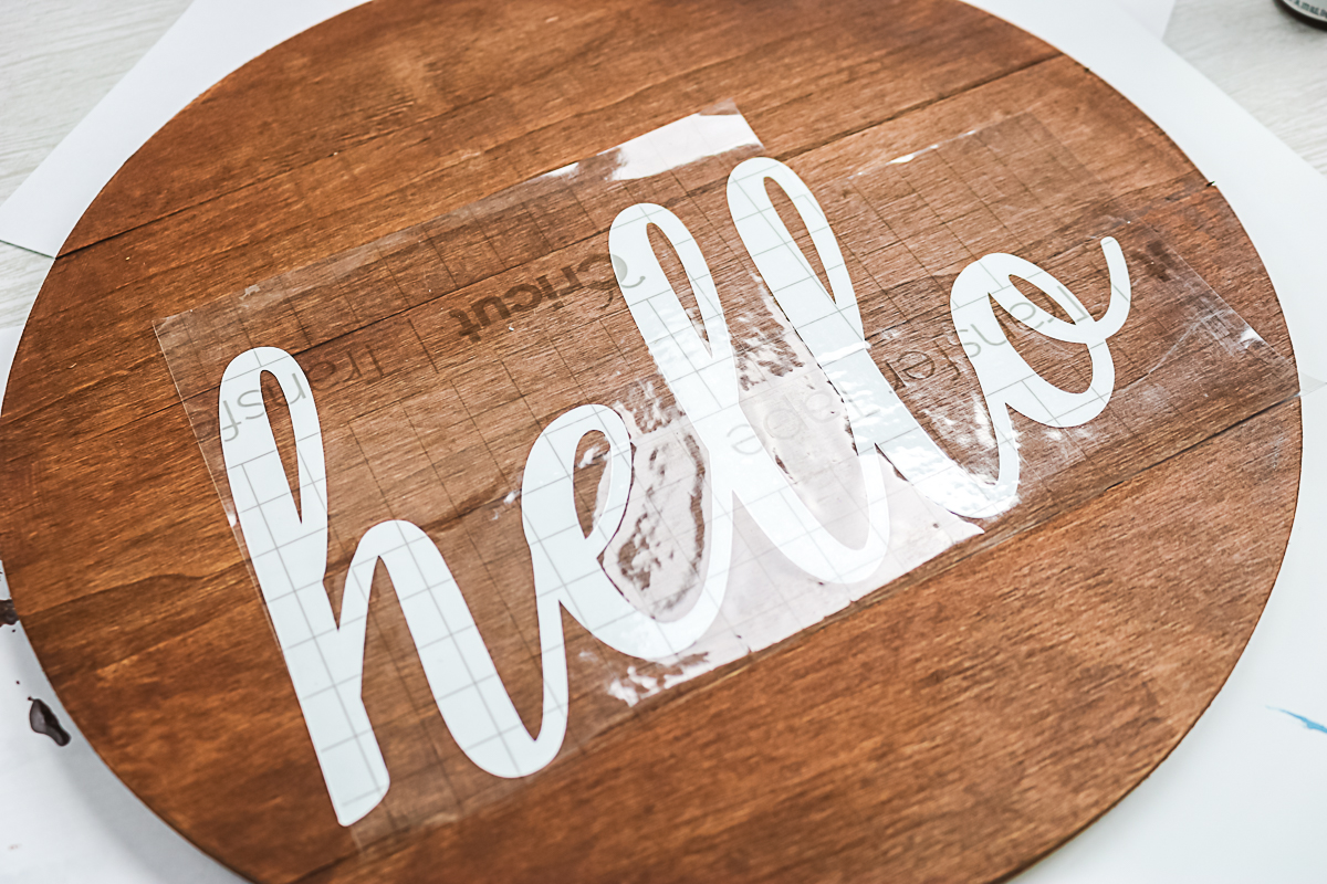 using transfer tape to move vinyl cut into the word hello