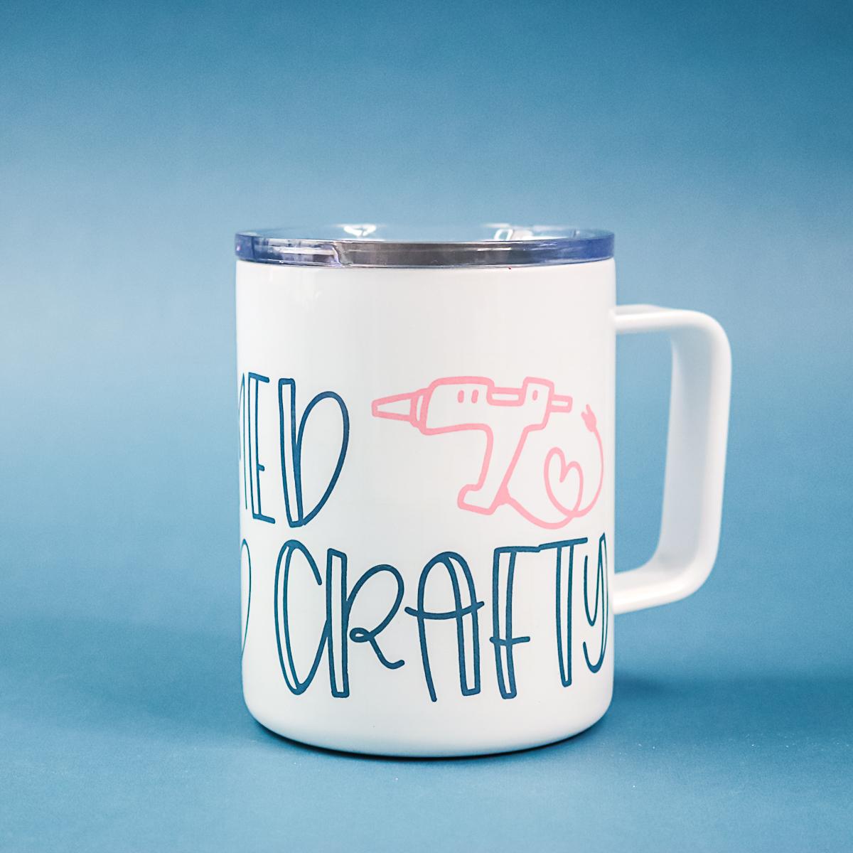 armed and crafty file on a coffee mug
